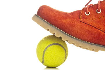 Tennis ball and red shoe