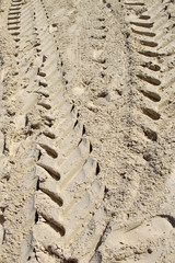 Tire Tracks in Sand Abstract