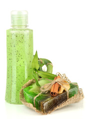 Bottle with scrub and hand-made soap, isolated on white