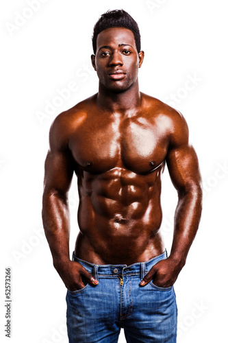 Shirtless strong man posing in style