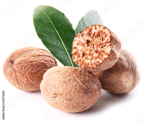 Nutmeg with leaves.