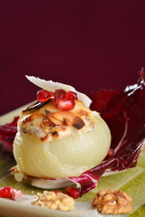 Steamed stuffed onions with goat cheese, walnuts
