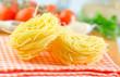 raw pasta and tomato