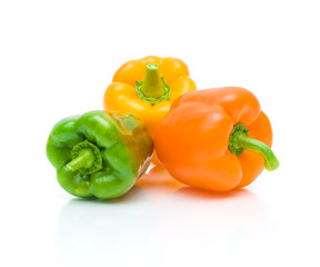 ripe sweet peppers on white background with reflection closeup
