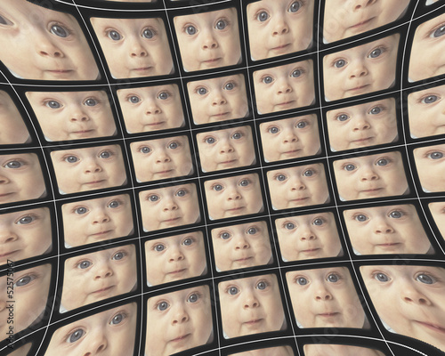 Distorted video screens showing the faces of a baby