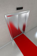 Closed elevator with red carpet in modern lobby