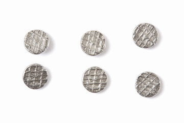 Metal nails head collection on white, clipping path