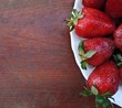 Strawberries on wooden table background