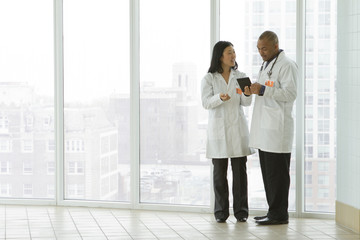 Wide shot of two doctors in a hospital