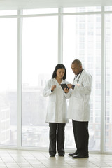 Two doctors looking at a tablet together
