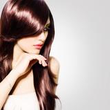 Hair. Beautiful Brunette Girl with Healthy Long Brown Hair