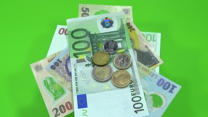 Euro and Romanian lei swirling in green background