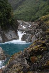 Fall between rocks