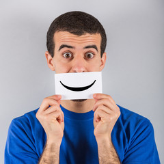 Young Man with Smiley Emoticon