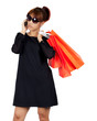 Young asian woman carries shopping bags
