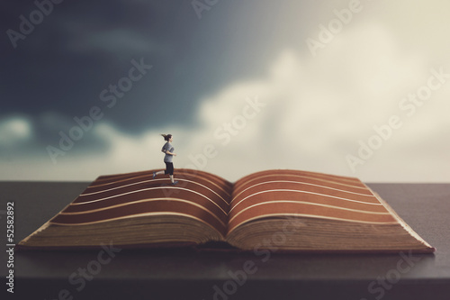 Woman running on a book