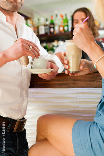 Attractive couple in cafe or coffeeshop