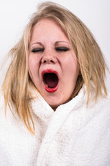 yawning very tired young woman