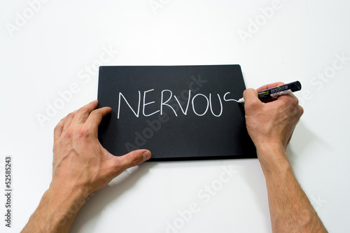 "two hand writing ""nervous"" on a black background"