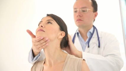Woman at the doctor checking a neck injury