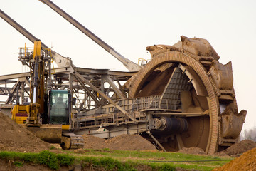 Large mining wheel of coal digger in action