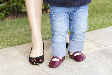 baby and mom legs