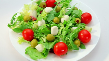 Salad with mozarella cheese - plate with vegetables salad