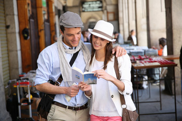 Trendy in love couple visiting Madrid