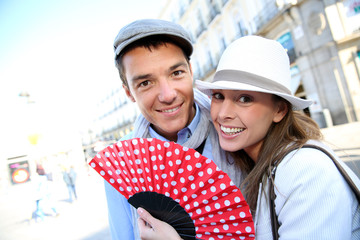 Cheerful couple enjoying week-end in Madrid