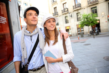 Romantic couple walking in the streets of Madrid, Spain