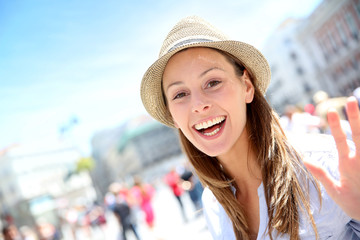 Portrait of cheerful beautiful girl in town