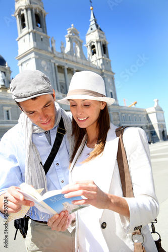Tourists standing by the Almudena Cathedral of Madrid