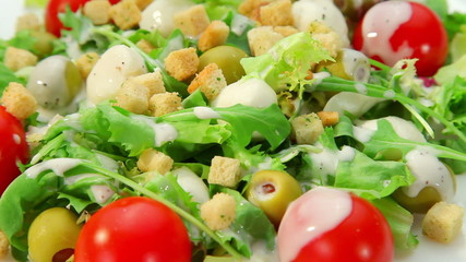 Vegetables salad with dressing, closeup