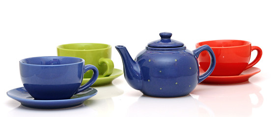 colorful tea cups with teapot isolated on white