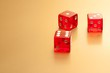 five red dice on golden background