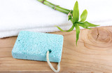 spa concept Pumice stone scrub tool on wood