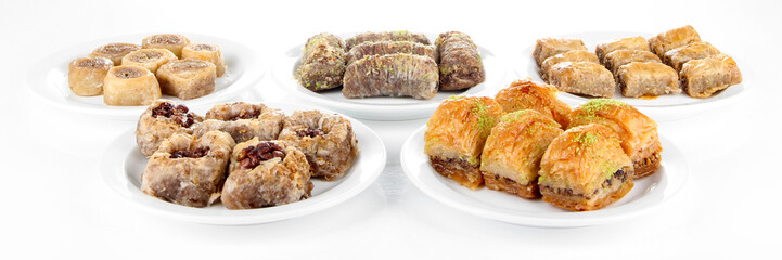 Sweet baklava on plates isolated on white