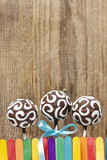 Chocolate cake pops on wooden background. Copy space.