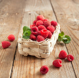 Fresh organic raspberry in basket. Selective focus