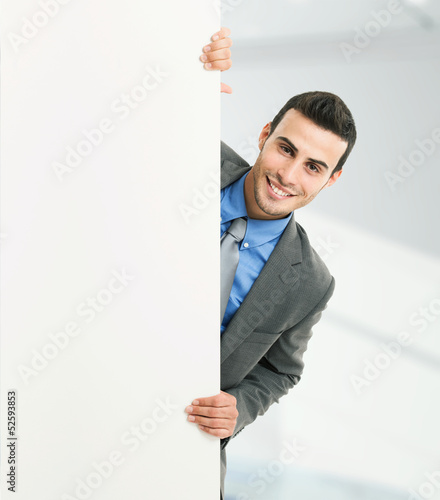 Smiling man showing a blank board