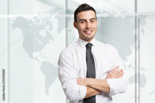 Confident businessman in front of a world map