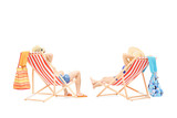 Couple relaxing on a sun loungers