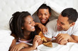 Family Enjoying Breakfast In Bed
