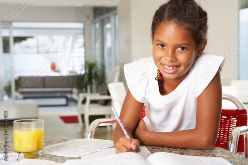 Girl Doing Homework In Kitchen