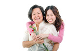 Asian women holding carnation flowers