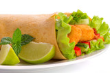 chicken tortilla wrap with lime and chili sauce on the plate