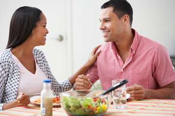 Couple Eating Meal Together At Home