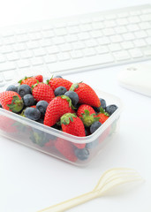 Berry mix lunch on working desk in office