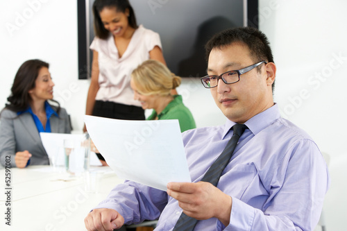 Portrait Of Businessman In Boardroom With Colleagues
