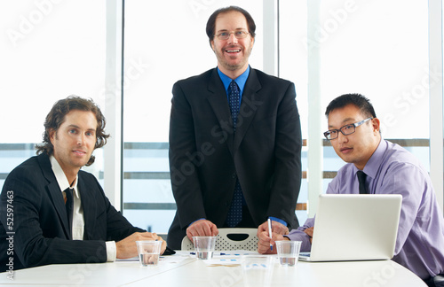 Group Of Businessmen Meeting In Office